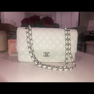 Chanel white caviar class double flap bag.